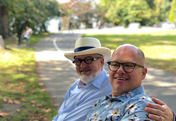 David and Patrick sitting on a bench in Stanley Park in Vancouver BC