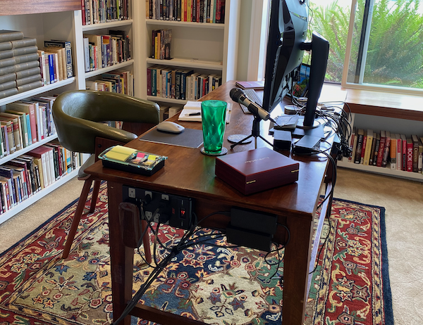 a desk with writing equipment in a library