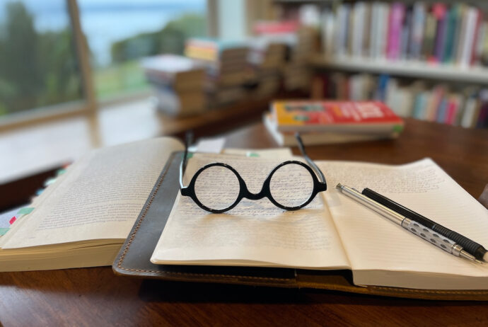 two books with glasses and mechanical pencil